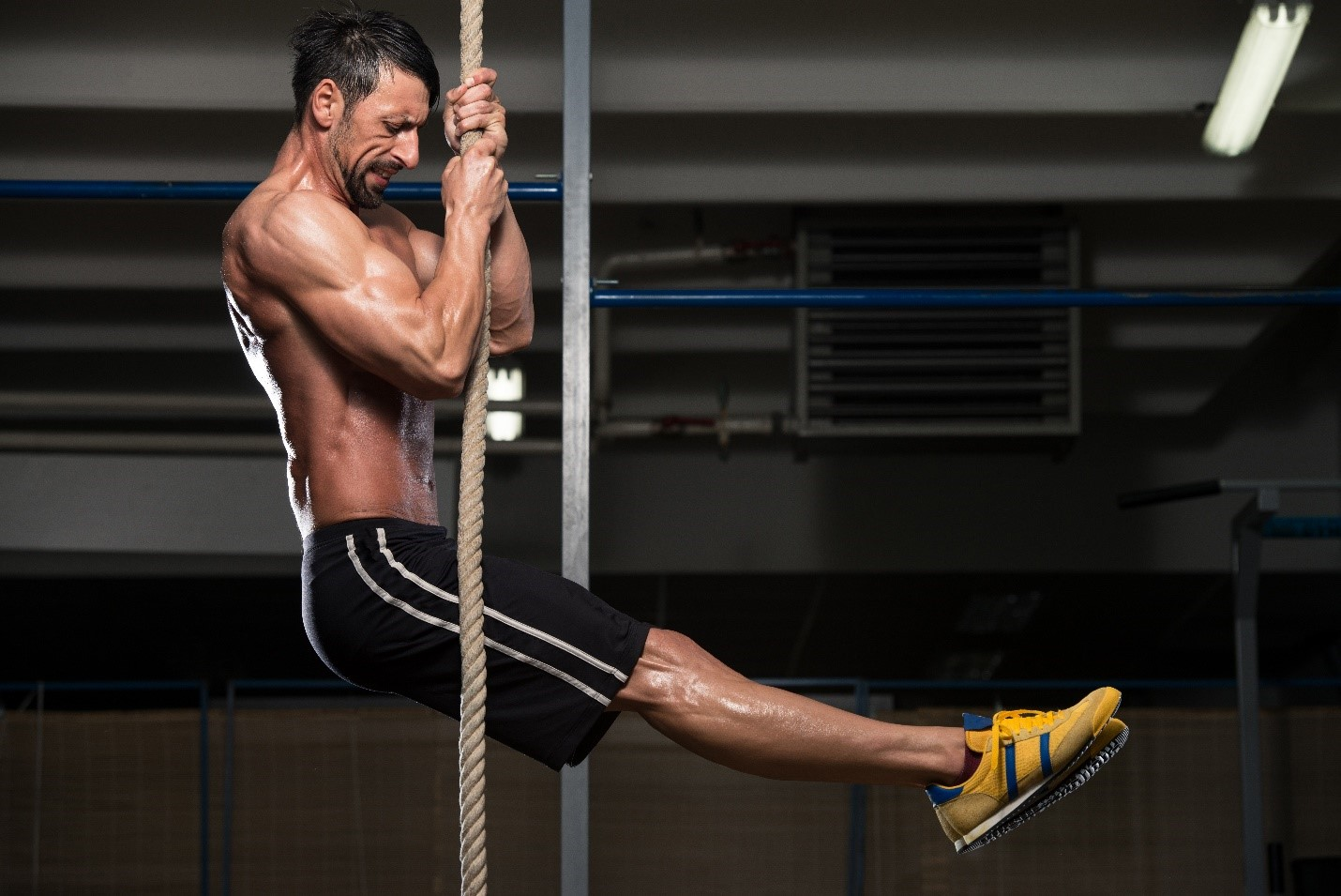 Man Climbing Rope Exercise